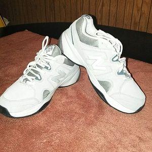 Pair of gray & white  new balance sneakers